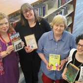 STRATEGIC SELECTORS (L.–r.) Erica Bartik, DVD and music buyer; Wendy Bartlett, adult fiction and ebook buyer;  Bonnie Easton, adult nonfiction buyer; and Mary Schreiber, children's book buyer. Not pictured, Melissa Barr,  alternative formats buyer. Photo by Mike Bullock